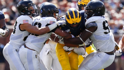<p>               Army defenders stop Michigan running back Zach Charbonnet (24) in the second half of an NCAA college football game in Ann Arbor, Mich., Saturday, Sept. 7, 2019. Michigan won 24-21 in overtime. (AP Photo/Paul Sancya)             </p>
