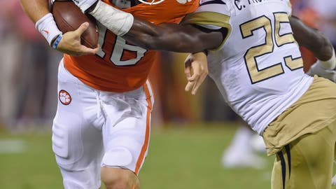<p>               Clemson quarterback Trevor Lawrence (16) breaks away from Georgia Tech's Charlie Thomas to gain a first down during the first half of an NCAA college football game Thursday, Aug. 29, 2019, in Clemson, S.C. (AP Photo/Richard Shiro)             </p>