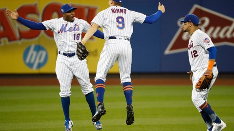 <p>               New York Mets left fielder Rajai Davis (18) celebrates with center fielder Brandon Nimmo (9) as right fielder Juan Lagares (12) heads toward the dugout after the Mets' 9-0 win over Arizona Diamondbacks in a baseball game Wednesday, Sept. 11, 2019, in New York. (AP Photo/Kathy Willens)             </p>