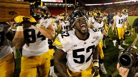 <p>               Iowa linebacker Amani Jones (52) celebrates after an NCAA college football game against Iowa State, Saturday, Sept. 14, 2019, in Ames, Iowa. Iowa won 18-17. (AP Photo/Charlie Neibergall)             </p>