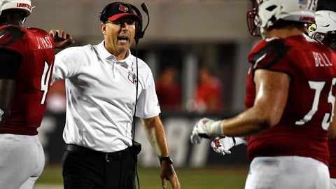 <p>               Louisville head coach Scott Satterfield instructs players during the second half of an NCAA college football game against Eastern Kentucky in Louisville, Ky., Saturday, Sept. 7, 2019. (AP Photo/Timothy D. Easley)             </p>