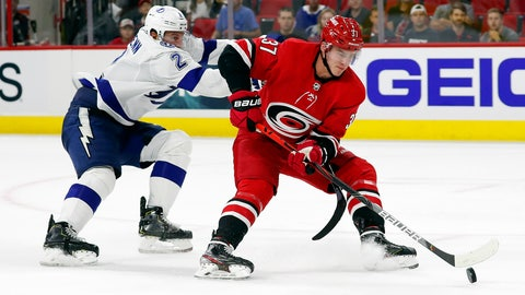 <p>               Tampa Bay Lightning's Luke Schenn (2) draws a hooking penalty as he tries to stop Carolina Hurricanes' Andrei Svechnikov (37) of Russia, during the second period of an NHL preseason hockey game, in Raleigh, N.C, Wednesday, Sept. 18, 2019, (AP Photo/Karl B DeBlaker)             </p>