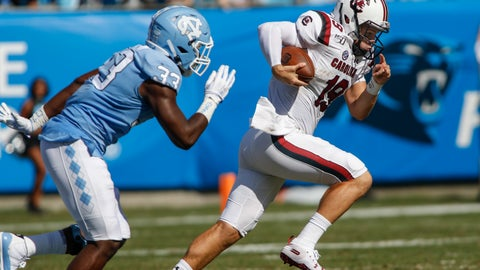 <p>               South Carolina quarterback Jake Bentley, right, carries the football as North Carolina linebacker Allen Cater chases in the first half of an NCAA college football game in Charlotte, N.C., Saturday, Aug. 31, 2019. (AP Photo/Nell Redmond)             </p>