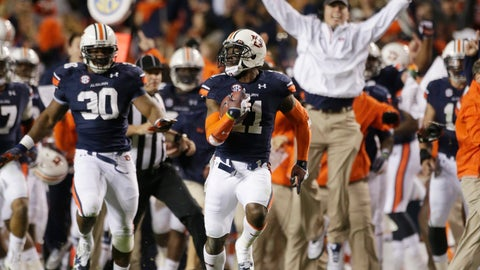 <p>               FILE - In this Nov. 30, 2013, file photo, Auburn cornerback Chris Davis (11) returns a field goal attempt 109-yards to score the winning touchdown over Alabama during the second half of the Iron Bowl NCAA college football game in Auburn, Ala. The 2013 Iron Bowl supplied one of the most famous plays in college football history. (AP Photo/Dave Martin, File)             </p>