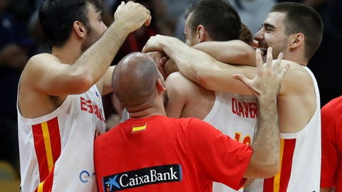 <p>               Spanish team players celebrate after defeating Serbia in their Group J second phase match for the FIBA Basketball World Cup, at the Wuhan Sports Center in Wuhan in central China's Hubei province, Sunday, Sept. 8, 2019. (AP Photo/Andy Wong)             </p>