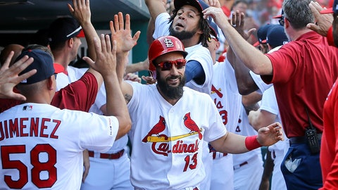 <p>               St. Louis Cardinals' Matt Carpenter, center, is congratulated by teammates after hitting a three-run home run during the third inning of a baseball game against the Chicago Cubs Sunday, Sept. 29, 2019, in St. Louis. (AP Photo/Scott Kane)             </p>
