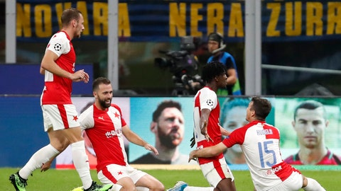 <p>               Slavia's Peter Olayinka, 2nd right, celebrates with teammates after scoring his sides first goal during the Champions League group F soccer match between Inter Milan and Slavia Prague at the San Siro stadium in Milan, Italy, Tuesday, Sept. 17, 2019. (AP Photo/Antonio Calanni)             </p>