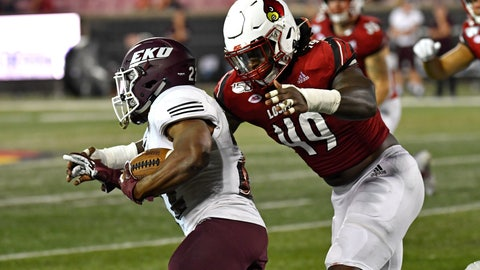 <p>               Louisville linebacker Boosie Whitlow (49) grabs Eastern Kentucky running back Daryl McCleskey Jr. (22) during the second half of an NCAA college football game in Louisville, Ky., Saturday, Sept. 7, 2019. (AP Photo/Timothy D. Easley)             </p>