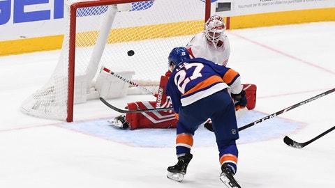 <p>               New York Islanders' Anders Lee (27) scores an overtime goal past Detroit Red Wings goaltender Jimmy Howard (35) during a preseason NHL hockey game Monday, Sept. 23, 2019, in Uniondale, N.Y. (AP Photo/Kathleen Malone-Van Dyke)             </p>