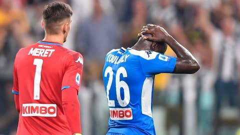 <p>               Napoli's Kalidou Koulibaly reacts after scoring the own goal that gave Juventus a 4-3 win, during the Italian Serie A soccer match Juventus and  Napoli at the Allianz Stadium in Turin, Italy, Saturday Aug. 31, 2019. (Alessandro di Marco/ANSA via AP)             </p>