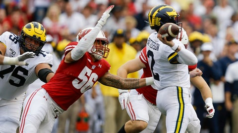 <p>               Wisconsin defensive end Rodas Johnson (56) goes after Michigan quarterback Shea Patterson (2) during the first half of an NCAA college football game Saturday, Sept. 21, 2019, in Madison, Wis. (AP Photo/Andy Manis)             </p>