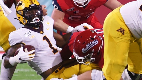 <p>               Fresno State's Kevin Atkins, right, with Fresno's Justin Rice, top right, tackles Minnesota's Rodney Smith, left ,during an NCAA college football game Saturday, Sept. 7, 2019, in Fresno, Calif. (Eric Paul Zamora/The Bee via AP)             </p>