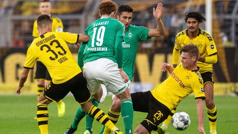 <p>               Dortmund's Julian Weigl, left, and Lukasz Piszczek, right, in action with Bremen's Josh Sargent, centre left, and Nuri Sahin, in action during their 6th round Bundesliga soccer match Borussia Dortmund against Werder Bremen at Signal Iduna Park in Dortmund, Germany, Saturday Sept. 28, 2019.(Bernd Thissen/dpa via AP)             </p>