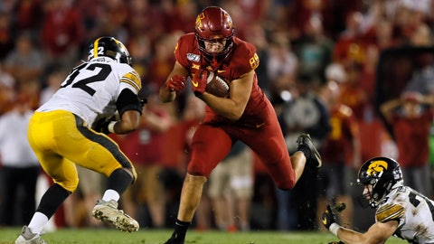 <p>               Iowa State tight end Charlie Kolar catches a pass between Iowa defenders Djimon Colbert, left, and Jack Koerner during the second half of an NCAA college football game Saturday, Sept. 14, 2019, in Ames, Iowa. Iowa won 18-17. (AP Photo/Charlie Neibergall)             </p>
