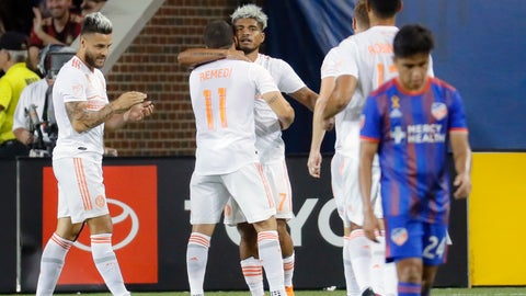 <p>               Atlanta United forward Josef Martinez, center, hugs midfielder Eric Remedi (11) after scoring in the second half of an MLS soccer match against the FC Cincinnati, Wednesday, Sept. 18, 2019, in Cincinnati. (AP Photo/John Minchillo)             </p>