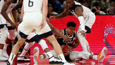 <p>               Greece's Giannis Antetokounmpo is surrounded by United States players as he fights to hold on to the ball during phase two of the FIBA Basketball World Cup at the Shenzhen Bay Sports Center in Shenzhen in southern China's Guangdong province on Saturday, Sept. 7, 2019. United States beats Greece 69-53. (AP Photo/Ng Han Guan)             </p>