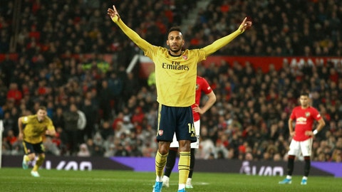 <p>               Arsenal's Pierre-Emerick Aubameyang celebrates after scoring the opening goal during the English Premier League soccer match between Manchester United and Arsenal at Old Trafford in Manchester, England, Monday, Sept. 30, 2019. (AP Photo/Dave Thompson)             </p>