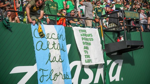 <p>               FILE - In this Aug. 23, 2019, file photo, Portland Timbers fans wait for the team's MLS soccer match against the Seattle Sounders in Portland, Ore. MLS is lifting its ban on signs and banners featuring an anti-Nazi symbol for the remainder of the season and the playoffs. A handful of fans in Portland were prohibited from attending matches this season after challenging a ban on the Iron Front, a symbol with three arrows pointed downward and to the left that was first used by an anti-Nazi paramilitary group in the 1930s. The league had said the emblem violated a ban on political displays included in the MLS fan code of conduct adopted this season. (Serena Morones/The Oregonian via AP, File)             </p>