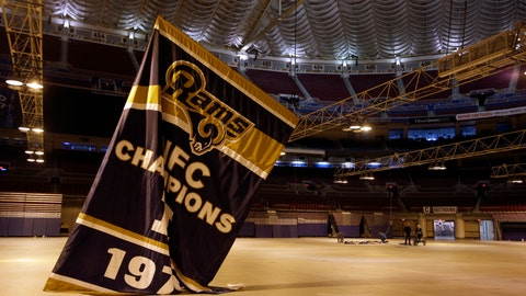<p>               FILE - In this Jan. 14, 2016, file photo, championship banners are removed from the Edward Jones Dome, former home of the St. Louis Rams football team, in St. Louis. The Missouri Supreme Court has ruled that a lawsuit filed over the Rams' departure from St. Louis will be heard in a St. Louis courtroom, a defeat for the NFL team's owner who sought to send the case to arbitration. The court issued its ruling Tuesday, Sept. 3, 2019, in a lawsuit filed by St. Louis city and county and the St. Louis Regional Convention and Sports Complex Authority, which owns the domed stadium where the Rams formerly played.  (AP Photo/Jeff Roberson, File)             </p>