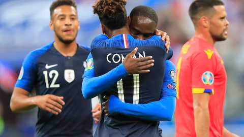 <p>               France's Kingsley Coman celebrates his opening goal with France's Jonathan Ikone during the Euro 2020 group H qualifying soccer match between France and Andorra at the Stade de France in Saint Denis, north of Paris, France, Tuesday, Sept. 10, 2019. (AP Photo/Michel Euler)             </p>