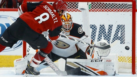 <p>               Arizona Coyotes center Nick Schmaltz (8) scores a goal against Anaheim Ducks goaltender Kevin Boyle, right, during the shootout in a preseason NHL hockey game Saturday, Sept. 21, 2019, in Glendale, Ariz. The Coyotes won 4-3. (AP Photo/Ross D. Franklin)             </p>
