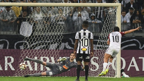 <p>               Luis Miguel Rodriguez of Argentina's Colon scores his side's first goal from the penalty spot during a second leg Copa Sudamericana semifinal soccer match against Brazil's Atletico Mineiro at the Mineirao stadium in Belo Horizonte, Brazil, Thursday, Sept. 26, 2019. (AP Photo/Eugenio Savio)             </p>
