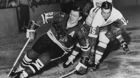 <p>               FILE - In this Feb. 24, 1965, file photo, Chicago Blackhawks' Stan Mikita, left, pulls away from Detroit Red Wings' Ted Lindsay during an NHL hockey game in Chicago. A posthumous study of  Mikita's brain shows the hockey Hall of Famer suffered from chronic traumatic encephalopathy at the time of his death a year ago. Dr. Ann McKee, the director of the BU CTE Center, announced the findings during the Concussion Legacy Foundation's Chicago Honors Dinner on Friday, Sept. 13, 2019, at the request of Mikita's family. (AP Photo/File)             </p>