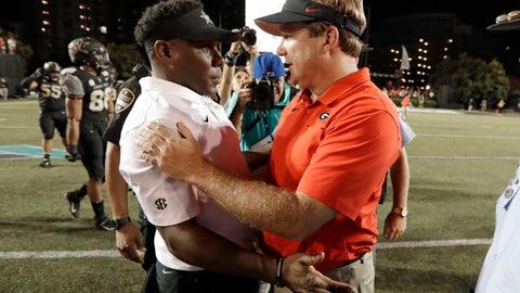 <p>               Vanderbilt head coach Derek Mason, left, congratulates Georgia head coach Kirby Smart after an NCAA college football game Saturday, Aug. 31, 2019, in Nashville, Tenn. (AP Photo/Mark Humphrey)             </p>