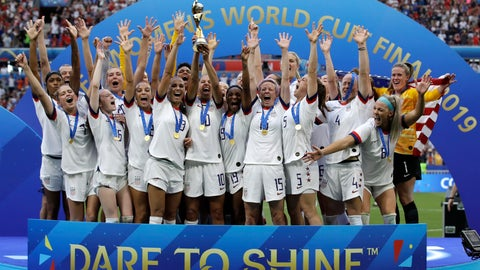 <p>               FILE - In this July 7, 2019, file photo, the United States team celebrates with the trophy after winning the Women's World Cup final soccer match against the Netherlands in Decines, France. Across the National Women's Soccer League (NWSL), attendance overall is up about 15 percent this year, with the most dramatic upward swings coming after U.S. national team's victory this summer at the World Cup in France. (AP Photo/Alessandra Tarantino, File)             </p>