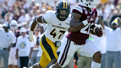 <p>               Mississippi State running back Nick Gibson (21) rushes for a touchdown as Southern Mississippi linebacker Terry Whittington (47) defends in the first half of an NCAA college football game Saturday, Sept. 7, 2019, in Starkville, Miss. (AP Photo/Jim Lytle)             </p>