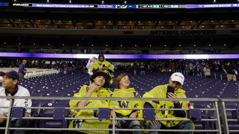 <p>               Fans wear ponchos after returning to their seats following a delay for severe weather during the first quarter of an NCAA college football game between Washington and California, Saturday, Sept. 7, 2019, in Seattle. (AP Photo/Ted S. Warren)             </p>