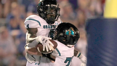 <p>               Coastal Carolina running back CJ Marable (1) celebrates his touchdown with offensive lineman Ethan Howard (75) during the second half of an NCAA college football game against Kansas in Lawrence, Kan., Saturday, Sept. 7, 2019. (AP Photo/Orlin Wagner)             </p>