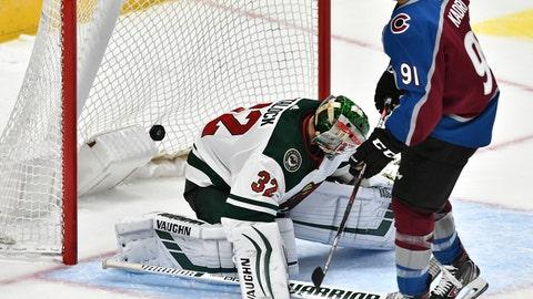 <p>               Colorado Avalanche center Nazem Kadri (91) scores a goal past Minnesota Wild goaltender Alex Stalock (32) during a shootout in an NHL preseason hockey game, Sunday, Sept. 22, 2019, in Denver. Colorado defeated Minnesota 3-2 in the shootout. (AP Photo/John Leyba)             </p>