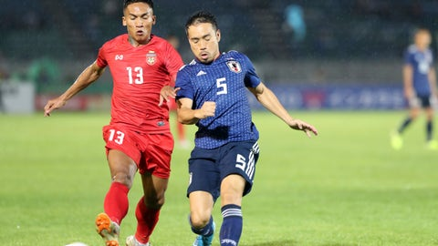 <p>               Myanmar's Kaung Sithu, left, vies for the ball with Japan's Auto Nagatomo during their FIFA World Cup 2022 qualifying soccer match at Thuwunna Stadium, Tuesday, Sept. 10, 2019, in Yangon, Myanmar. (AP Photo/Thein Zaw)             </p>