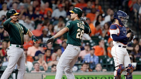 <p>               Oakland Athletics Marcus Semien, left, and Matt Olson, center, celebrate at the plate next to Houston Astros catcher Robinson Chirinos, right, after they scored on a two-run home run by Olson during the third inning of a baseball game Thursday, Sept. 12, 2019, in Houston. (AP Photo/Michael Wyke)             </p>