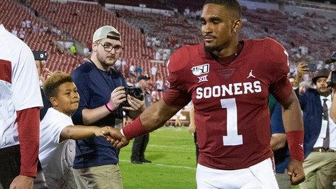 <p>               Oklahoma quarterback Jalen Hurts (1) greets a fan following an NCAA college football game against Houston in Norman, Okla., Sunday, Sept. 1, 2019. Oklahoma won 49-31. (AP Photo/Alonzo Adams)             </p>