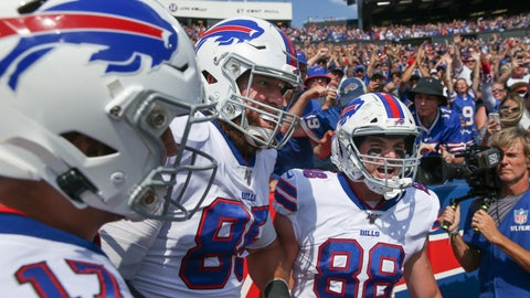 <p>               CORRECTS DATE - Buffalo Bills' Dawson Knox (88) celebrates with teammates Lee Smith (85) and Josh Allen (17) after scoring a touchdown during the first half of an NFL football game against the Cincinnati Bengals, Sunday, Sept. 22, 2019, in Orchard Park, N.Y. (AP Photo/John Munson)             </p>