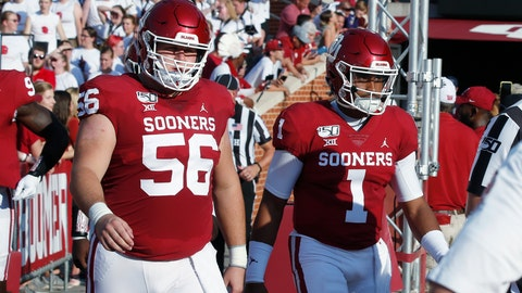<p>               In this photo taken Sept. 7, 2019, Oklahoma offensive lineman Creed Humphrey (56) and quarterback Jalen Hurts (1), two of the team's captains, walk onto the field before an NCAA college football game against South Dakota in Norman, Okla. Oklahoma lost four starters from last year's offensive line to the NFL draft, but this year's unit has fueled an attack that leads the nation in total offense. (AP Photo/Sue Ogrocki)             </p>