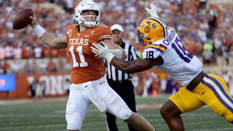 <p>               Texas quarterback Sam Ehlinger throws a pass as LSU linebacker K'Lavon Chaisson defends during the first half of an NCAA college football game Saturday, Sept. 7, 2019, in Austin, Texas. (AP Photo/Eric Gay)             </p>