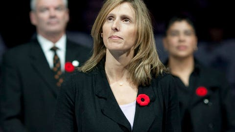 <p>               FILE - In this Nov. 6, 2010, file photo, Cammi Granato stands on center ice after being inducted into the Hockey Hall of Fame before an NHL game between the Toronto Maple Leafs and the Buffalo Sabres in Toronto. Seattle's expansion NHL franchise has hired former U.S. Olympic team captain Cammi Granato as a pro scout. Granato is one of a handful of women working on the hockey operations side of an NHL franchise and she is the only female pro scout currently in the league. (Chris Young/The Canadian Press via AP, File)             </p>