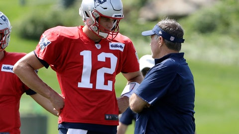 <p>               New England Patriots quarterback Tom Brady (12) speaks with head coach Bill Belichick, right, during NFL football practice, Wednesday, Sept. 11, 2019, in Foxborough, Mass. (AP Photo/Steven Senne)             </p>