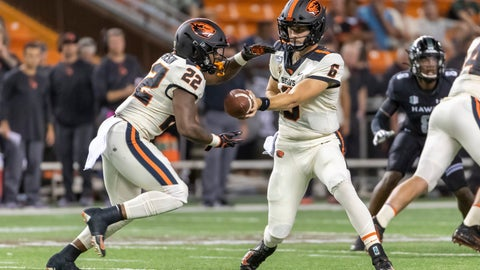 <p>               Oregon State quarterback Jake Luton (6) hands off the football to his running back Jermar Jefferson (22) during the first half of an NCAA college football game, Saturday, Sept. 7, 2019, in Honolulu. (AP Photo/Eugene Tanner)             </p>