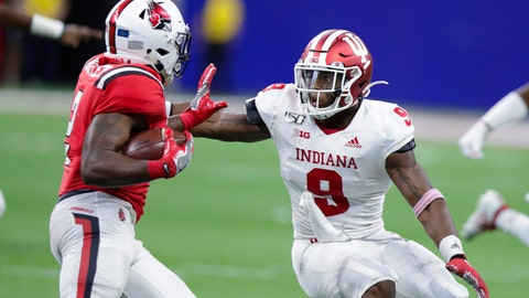 <p>               Indiana defensive back Marcelino Ball (9) tackles Ball State running back Caleb Huntley (2) during the second half of an NCAA college football game in Indianapolis, Saturday, Aug. 31, 2019. Indiana defeated Ball State 34-24. (AP Photo/Michael Conroy)             </p>