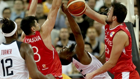 <p>               United States' Kemba Walker is blocked by Turkey's Ersan Ilyasova, second from left and Turkey's Sertac Sanli at right during a Group E match for the FIBA Basketball World Cup at the Shanghai Oriental Sports Center in Shanghai on Tuesday, Sept. 3, 2019. The United States beat Turkey 93:92.(AP Photo/Ng Han Guan)             </p>