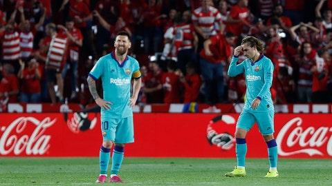 <p>               Barcelona's Messi, right, and Antoine Griezmann react during the Spanish La Liga soccer match between Barcelona and Granada at the Los Carmenes stadium in Granada, Spain, Saturday, Sep. 21, 2019. Ganada won 2-0.(AP Photo/Miguel Morenatti)             </p>