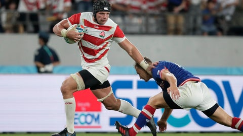 <p>               Japan's Pieter Labuschagne, left, fends off Russia's Yury Kushnarev on his way to scoring a try during the Rugby World Cup Pool A game at Tokyo Stadium in Tokyo, Friday, Sept. 20, 2019. (AP Photo/Jae Hong)             </p>