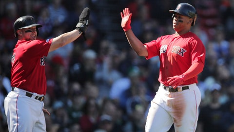 <p>               Boston Red Sox's Christian Vazquez, left, and Rafael Devers high-five after scoring on an Xander Bogaerts two RBI single during the second inning of a baseball game against the San Francisco Giants at Fenway Park in Boston, Thursday, Sept. 19, 2019. (AP Photo/Charles Krupa)             </p>