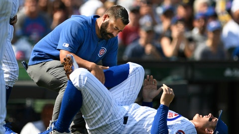 <p>               Chicago Cubs' Anthony Rizzo is tended to after spraining his ankle during the third inning of a baseball game against the Pittsburgh Pirates Sunday, Sept. 15, 2019, in Chicago. (AP Photo/Paul Beaty)             </p>