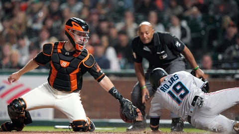 <p>               Miami Marlins' Miguel Rojas (19) is safe at home as San Francisco Giants catcher Buster Posey, left, can't make the tag in time during the eighth inning of a baseball game Saturday, Sept. 14, 2019, in San Francisco. (AP Photo/Tony Avelar)             </p>