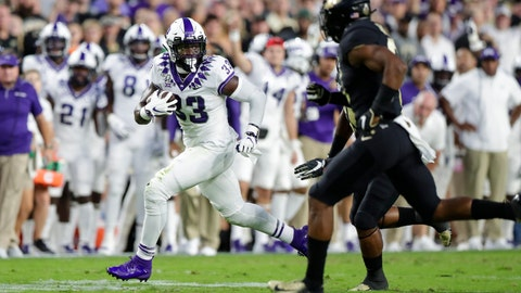 <p>               TCU running back Sewo Olonilua (33) looks to get past Purdue safety Jalen Graham (6) during the first half of an NCAA college football game in West Lafayette, Ind., Saturday, Sept. 14, 2019. (AP Photo/Michael Conroy)             </p>